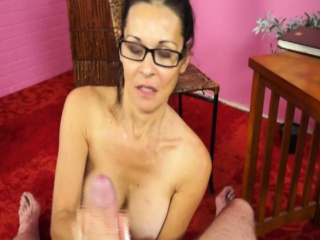 Busty milf with spex jerking hard dick