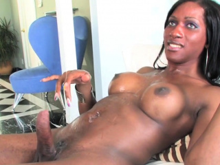 Black wanking TS sprays big load of jizz