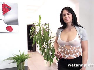 Julia Black is a dark haired milf in white fishnets who likes to masturbate on the floor