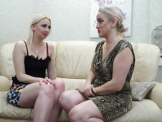 Two mature lesbians are making love on the couch and moaning from pleasure while cumming