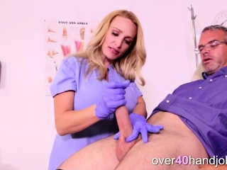 Handjob by busty blonde MILF