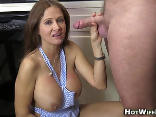 Busty brunette is getting hammered in the kitchen while her husband is on his way home
