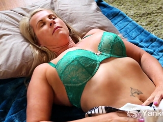 MILF Eva Moore is a joy to watch. She lays down a towell on