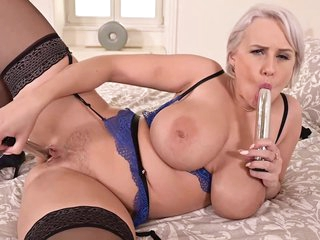 Busty blonde woman, Angel Wicky is playing with herself while alone at home and even moaning