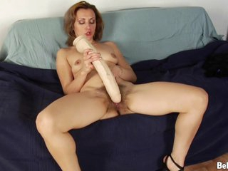Hairy amateur housewife tok off her panties and started drilling that wet pussy on the couch
