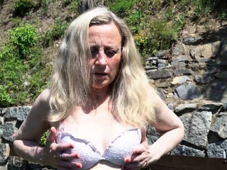 A walk outside turns hot in a hurry when horny MILF Andrea